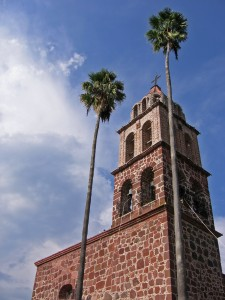 Church tower and palms